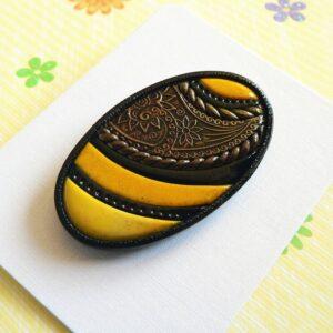 Brož žluto černá