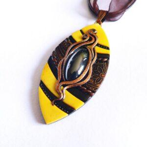 Náhrdelník žluto černý s očkem