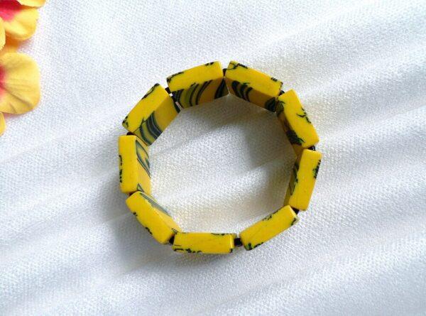 Náramek žlutý pružný