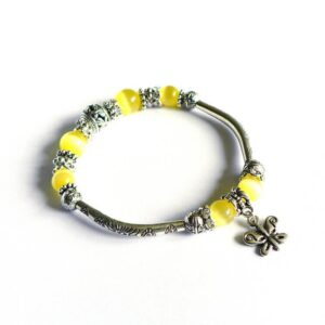 Žlutý náramek, skleněné korálky Kočičí oči